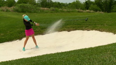 Golf lady in sand bunker  Stock Footage
