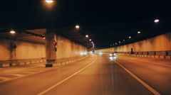Automobile tunnel at night on which cars go Stock Footage