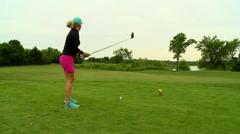 Golf woman in tee box Stock Footage