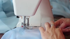 Woman sews on the sewing machine. Women's hands. Close-up Stock Footage