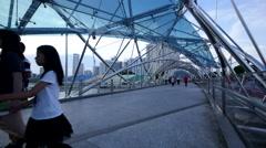 Timelapse Singapore People walking on Helix Bridge Stock Footage