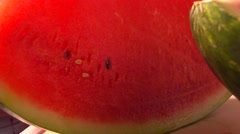 Cut watermelon closeup 4K pan shot Stock Footage