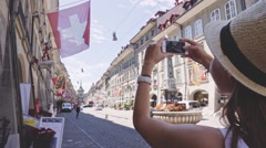 Tourist Woman Taking Photographs in Bern, Switzerland. SLOW MOTION 240 fps. Stock Footage