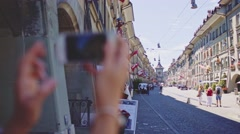 Tourist Woman Taking Photographs in Bern, Switzerland. 4K. Travel Europe Stock Footage