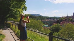 Tourist Woman Taking Photographs in Bern, Switzerland. 4K. Travel Europe. Stock Footage