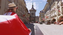 Tourist Walking with a Swiss Flag on Kramgasse, Bern, Switzerland. 4K Stabilized Stock Footage