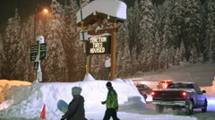 Stevens Pass, WA 12-27-15: Snow Covered Parking Lot with Skiers and Snowboarder Stock Footage
