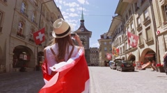 Tourist Woman Making Phone Video in Bern, Switzerland. 4K Steadicam shot Stock Footage