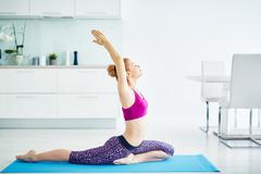 Woman in Kapotasana Yoga Pose Stock Photos