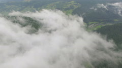 Aerial view of clouds over a mountain forest Stock Footage