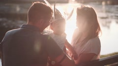 Young family with Baby Girl Enjoying evening in the Park. Slow Motion 120 fps 4K Stock Footage