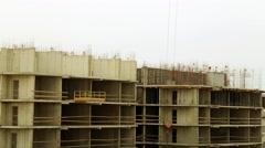 House under construction. Construction crane lifts cargo. Stock Footage