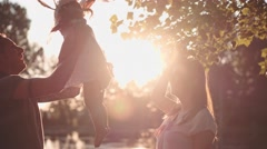 Young family with Toddler Enjoying Evening in the Park. Slow Motion 120 fps 4K Stock Footage