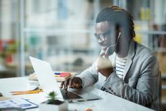 African - American Entrepreneur in Office Stock Photos