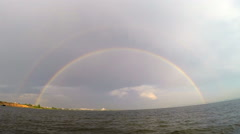 Rainbow above river Stock Footage