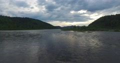 Cloudy sky is reflected in the surface of the river Stock Footage