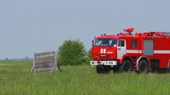 Panning shot of fire engine driving on airfield during a training at Boryspil Stock Footage