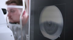Male patient on a eye examination. Medical attendance at the optometrist in a Stock Footage