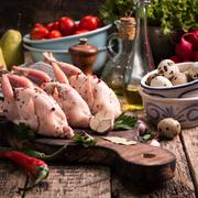 Fresh organic quails on vintage wooden table, healthy food Stock Photos