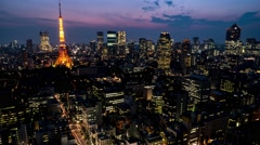 Night Tokyo city view with glowing Tokyo Tower. 4K resolution time lapse zoom in Stock Footage