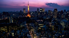 Evening Tokyo city view with Tokyo Tower lighting up.  4K resolution time lapse. Stock Footage