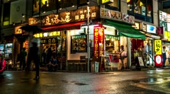 Tokyo - Small lane with restaurants and people in rainy night. Nakano. 4K Stock Footage