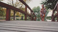 Young Couple in Love, 4K. Two romantic people are walking in the autumn park. Stock Footage