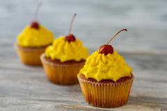 Cupcakes with yellow frosting. Stock Photos