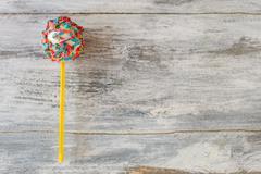 Cake pop with sprinkles. Stock Photos