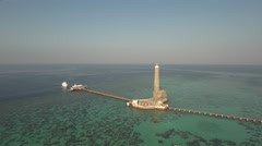 Aerial view of lighthouse on the coral reef - Sanganeb, Red Sea, Sudan Stock Footage