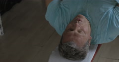 Close-up shot of a man being rather tired with pull over chest exercise Stock Footage