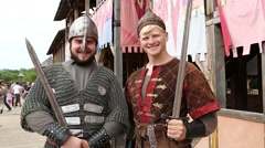 Two warriors in armours with swords, Kyivan Rus park, Kopachiv village, Ukraine Stock Footage