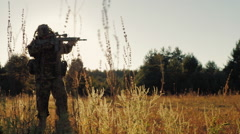 Steadicam shot: Silhouette of armed men, taking aim through the weapon goes Stock Footage
