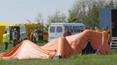 Rescuers laid out a tent for a field hospital during a simulated airplane crash Stock Footage