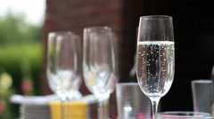 A champagne glass close up in outdoors blur background HD Stock Footage