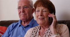 4k, Senior couple talking on the phone to their grand children. Stock Footage