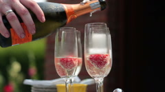 Champagne pouring into glasses, slow motion HD Stock Footage