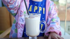 Little girl child in cafe  - kid drinking milk cocktail cacao with milk Stock Footage