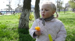 Little child girl in a park play with soap bubbles having fun slow motion Stock Footage