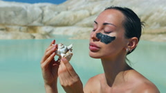 Woman with Black Clay Facial Mask. Beauty, Wellness. Spa Outdoor Stock Footage