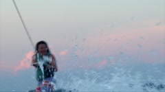 Water splashing with rack focus wakeboarder girl Stock Footage