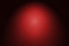 Spotlight on red carbon fiber background. Stock Illustration