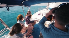 Friends sailing in the sea Stock Footage