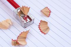 Color red art pencil on a sharpener Stock Photos