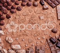 Still life of chocolate in cocoa Stock Photos