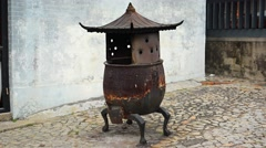 Antique Iron Fire Pot outside Buddhist Temple in Macau. Video 4k Stock Footage