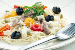 Pasta with anchovies, capers and olives Stock Photos