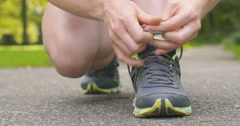 Runner Tying Shoe Laces Stock Footage