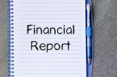 Financial report text concept on notebook Stock Photos