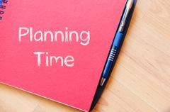 Planning time text concept on notebook Stock Photos